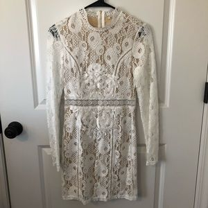 Long sleeved white lace dress